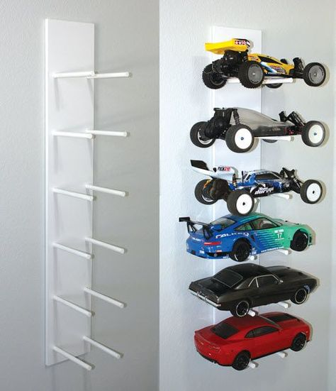 Heres a car rack thats easy on the eyes and the budget. All you need is 48 x 8 pre-finished shelf and two 48 x dowels. Rc Cars And Trucks, Toy Trucks, Wiking Autos, Truck Storage, Toy Car Storage, Closet Storage, Car Bedroom, Bedroom Ideas, Car Racks