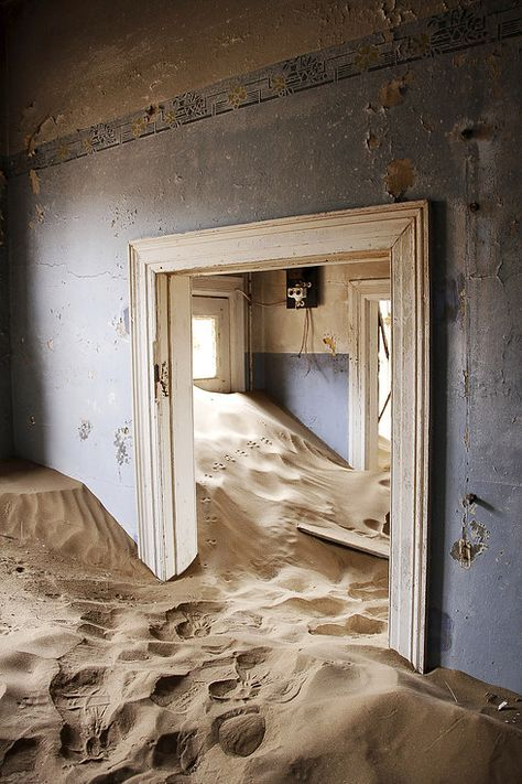 Most Dark And Mysterious Places On Earth Kolmanskop, Namibia : A former diamond mining town in the Namib Desert where geological forces have buried many houses in sand.Buried Alive Buried alive refers to a premature burial. Buried Alive may also refer to: Abandoned Buildings, Abandoned Places, Mysterious Places On Earth, Witches Of East End, Namib Desert, Exotic Places, Another World, Places To Go, Dark Places