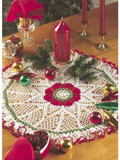 "Crocheters who enjoy pineapple patterns and Christmas will be especially delighted with this project, which combines both styles into one beautiful doily! Size: Approx 18"" diameter plus ruffle.Skill Level: Confident Beginner"
