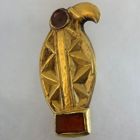 Meroving silver gilt brooch, with inlaid garnets in the shape of a raven (a symbol of the pagan god Wodin). ca 450 A.D. The back is left silver and has similar brooch fitting as Roman brooches have.
