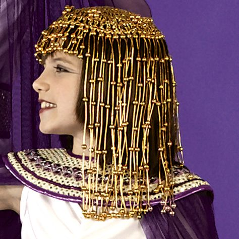 Cleopatra Headpiece Description: Ready to rule the Nile! The perfect match to any Egyptian Queen's disguise. Features a dangling gold headpiece that i