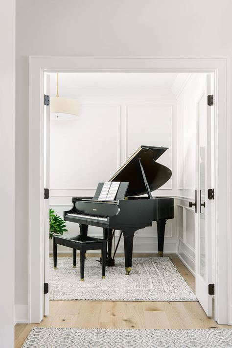 Applied molding walls, painted Benjamin Moore White Dove set the backdrop for our client's beloved baby grand piano. By Jillian Lare Interior Design – Des Moines, Iowa. Grand Piano Room, Piano Room Decor, Piano Living Rooms, Iowa, White Piano, Baby Grand Pianos, Furniture Styles, Kitchen Remodel, Interior Design
