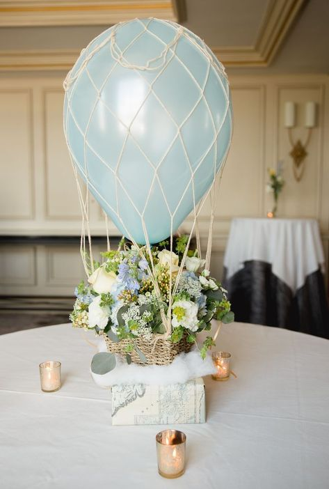 This baby boy shower theme combines travel and hot air balloons for a cute up, up and away idea! Balloon centerpieces, cotton cloud accents and printed map stationery bring the whole unique theme together. - Up, Up and Away Baby Shower Party Theme Cloud Baby Shower Theme, Boy Baby Shower Themes, Baby Shower Balloons, Baby Balloon, Balloon Party, Boy Baby Showers, Raindrop Baby Shower, Hot Air Balloon Centerpieces, Baby Shower Table Centerpieces