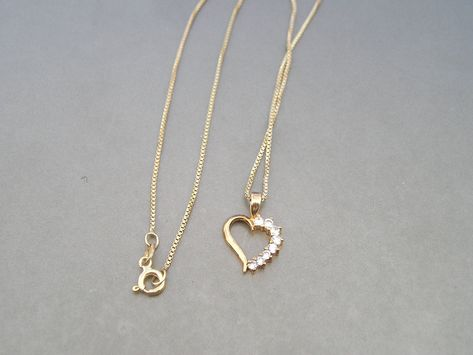 """""""nice gold over sterling and CZ heart pendant necklace. Pendant is marked 925 PAJ and measures about 3/4\"""" in length - chain measures 18\"""" in length and is marked 925 Italy- some light tarnish... please look at all the photos PLEASE CHECK OUT MY OTHER VINTAGE ITEMS NO LONGER SHIPPING INTERNATIONAL I DO NOT CLEAN OR POLISH JEWELRY - AFTER MY NUMEROUS YEARS OF SELLING, MOST PEOPLE LIKE THE PATINA AND TARNISH... IF YOU WOULD LIKE ME TO POLISH A PIECE OF JEWELRY ALL YOU HAVE TO DO IS ASK! THANK YOU"""
