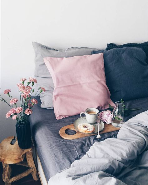 It was this set of blueish grey linen pillows that ignitedmy chambray bedding obsession. I'm smitten with the layering ofblue hues on the bed, especially with a pop of warm pastel pink to offset the cool tones. I'm doing it. Stay tuned.