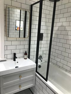 Beautiful White Bathroom Featuring Black Framed Overbath Shower Screen Black Bathroom Ideas Bath Shower Doors Bath Shower Screens Space Saving Bathroom