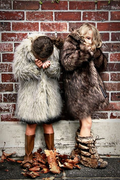 little small girls laughing giggling fur coat jack jacket anorak grey brown winter style fashion clothes