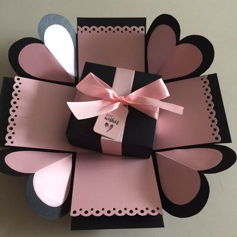 "Buy DIY Explosion Box In Black And Light Pink in Singapore,Singapore. ----------- Info ------------- Size: 4x4""  Explosion box card with 2 layers, 4 heart flaps ribbon and tag    $6.50 per box   Email mayling77@gmail.com or Whatsa Chat to Buy"