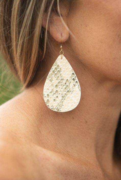 These super trendy faux leather teardrop earrings come in super cute metallic, snakeskin pattern. #jewelry #cutejewelry #accessories #accessorize #pretty #gold #trendy #cute #chic #earrings #dropearrings #snakeskin