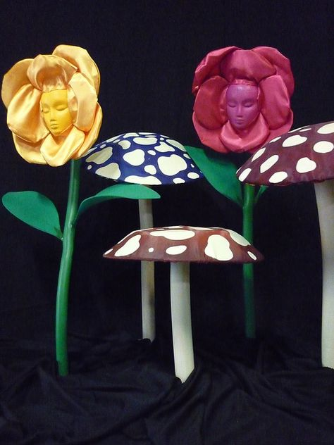 -Make photo prop.  Use cardboard and paint flowers and mushrooms. Hole for face in flowers. 3D make pedals our of felt or other fabric.  alice in wonderland props by jules the decorator, via Flickr