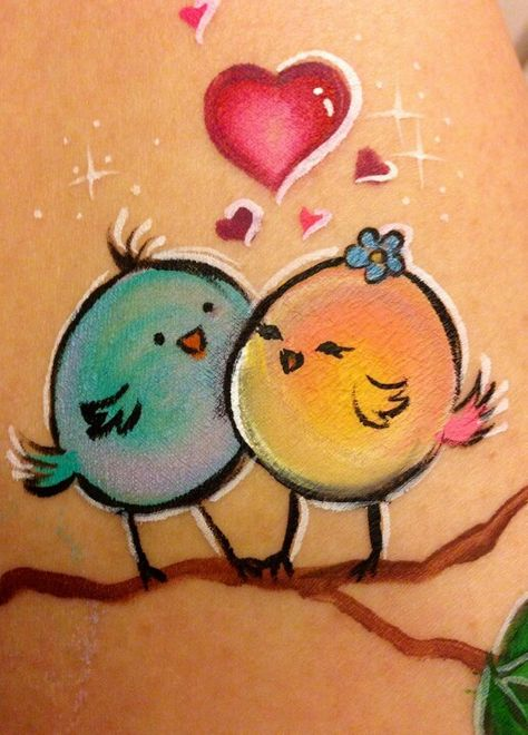 Love birds face painting using pouncers Face Painting Designs, Paint Designs, Easter Face Paint, Cheek Art, Belly Painting, Maquillage Halloween, Animal Paintings, Face Paintings, Whimsical Art