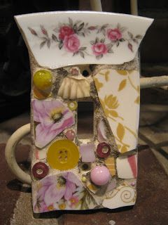 Mosaic single switch plate in pink and yellow, mosaic art.