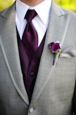 Grey jacket, purple vest, purple tie, and a purple boutonnière make this a classic and stylist wedding suit.