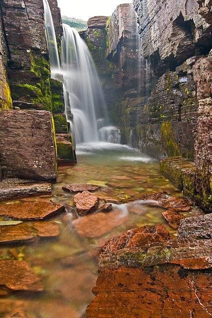 Triple Falls, Glacier National Park, Montana. Just enough of some mindcraft unrealness to satisfy your descent.