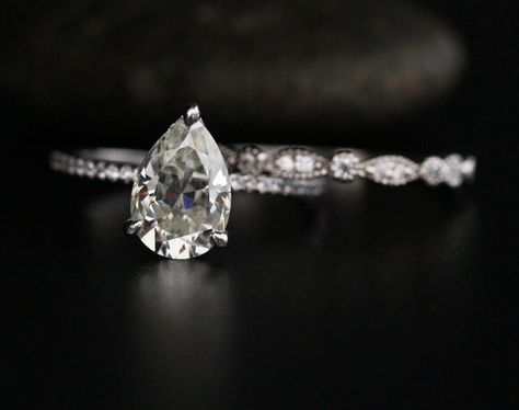 10x7mm Pear Moissanite Ring Brilliant Moissanite Engagement Ring and Diamond Wedding Band Bridal Ring Set in 14k White Gold by Twoperidotbirds on Etsy https://www.etsy.com/listing/486495349/10x7mm-pear-moissanite-ring-brilliant