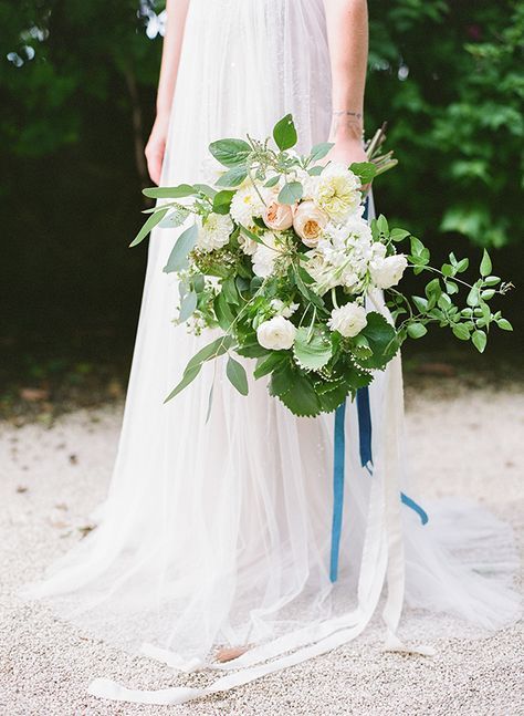 Green, white and navy wedding bouquet.