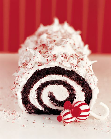 How do you make a buche de noel even more festive? Add peppermint, of course! Red velvet cake is rolled up and slathered with peppermint frosting, then sprinkled with crushed candy canes. Christmas Yule Log, Christmas Desserts, Christmas Treats, Christmas Baking, Holiday Foods, Winter Christmas, Christmas Recipes, Christmas Cookies, Chocolate Yule Log Recipe