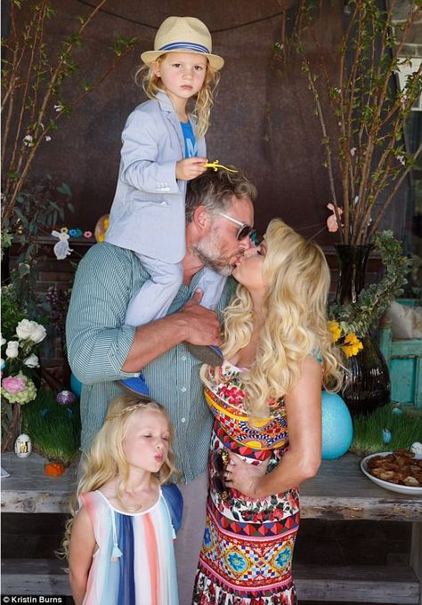 Jessica Simpson looks incredible as she kisses husband Jessica is seen kissing her husband Eric Johnson, while their four-year-old daughter Maxwell Drew and three-year-old son Ace Knute cling to their parents.