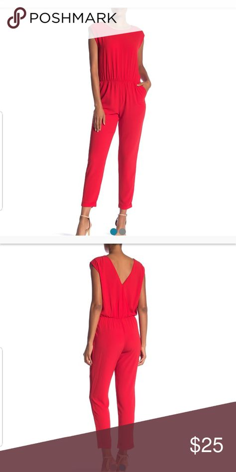 "*Perfect for Valentines Date* Cap Sleeve Jumpsuit Create a stylish look in this cap sleeve jumpsuit with shoulder zip details, an elastic waist, and back button closure. Fit: this style fits true to size. - Crew neck - Cap sleeves - Shoulder zip details - Back button closure - Elastic waist - Solid - Approx. 54"" length, 32"" inseam (size S) Sharagano Pants Jumpsuits & Rompers"