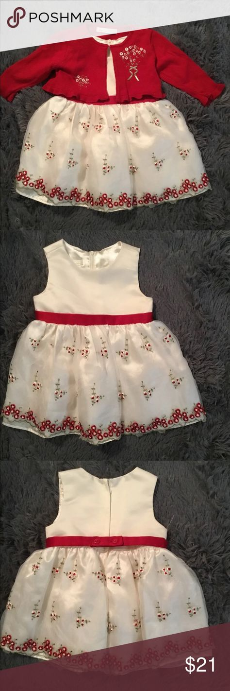 AMERICAN PRINCESS DRESS & SWEATER. 18 MONTHS AMERICAN PRINCESS WHITE WITH RED TRIM DRESS AND RED SWEATER. 18 MONTHS. DRESS IS 100% POLYESTER SWEATER IS 55% COTTON 45% ACRYLIC. DRESS HAS HALF SLIP WITH NETTING ON BOTTOM, THEN A WHITE SILKY SHINY HALF SLIP. TOP OF DRESS IS WHITE. ZIPS UP BACK. HAS RED BELT AROUND WAIST WITH TWO BUTTONS IN BACK. BOTTOM OF SKIRT IS WHITE WITH RED FLOWERS. SWEATER IS RED WITH WHITE FLOWERS MATCHING SKIRT American Princess Dresses
