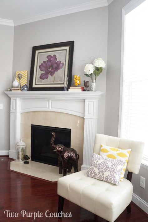 Purple and yellow make for bright spring colors on this fireplace mantel.