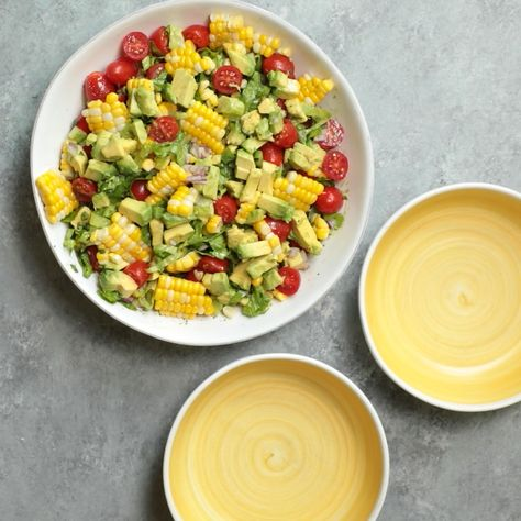 This Corn Tomato Avocado Salad is a quintessential and easy vegan summer recipe made with fresh vegetables and tossed with lime juice, olive oil & cilantro