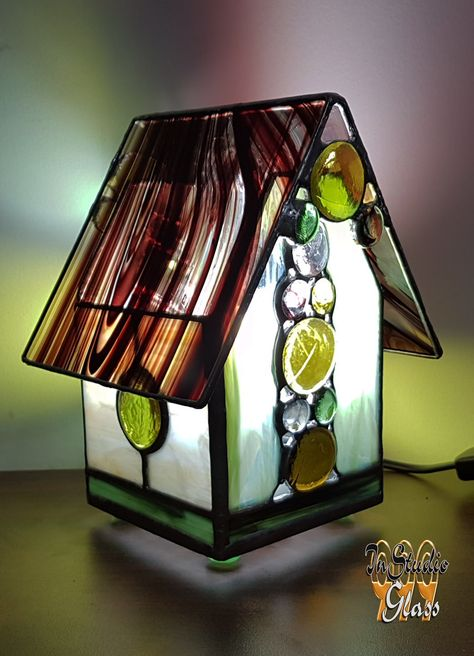 My stained glass night lamp, made in the form of a house ornament, is a beautiful and useful thing, that deserves your attention. This bedside lamp can be used both for decorating your own bedroom decor, or kids room decor. This baby night lamp looks a little fairy, and that is why children will like it. The stained glass house looks really good when the lamp is on. Stained glass art has many different items, but you barely find a more unique one, then a lamp, made in the form of a fairy house.