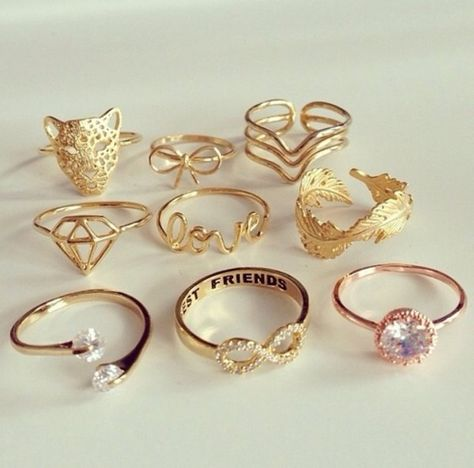jewels diamonds jewelry beautiful gold gold jewelry girl girly tiger ring feathers infinite love triple ring gold ring justin bieber hipster jewelry fashion style trendy gold sequins gold midi rings