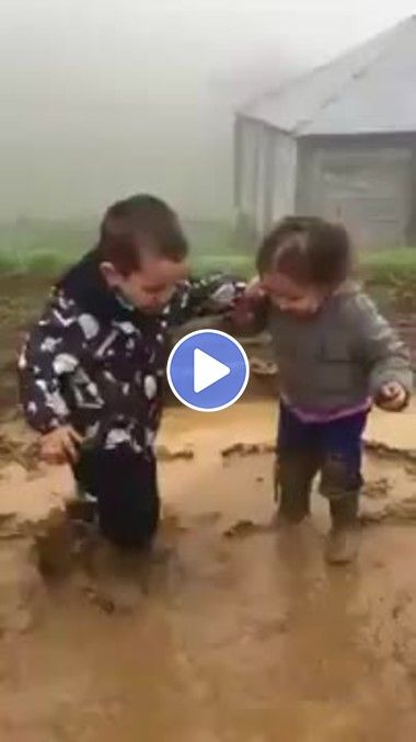 Kids have fun playing in the mud - Animated GIF