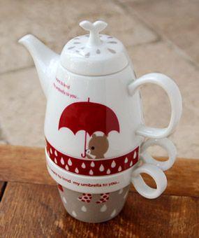 ceramic teapot and cups set designed by shinzi katoh