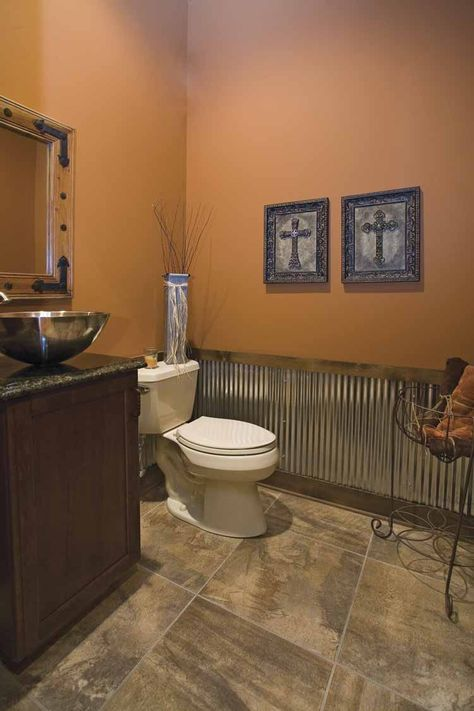 Vessel sink, tin wainscoting, and a dark brown paint for the guest bathroom