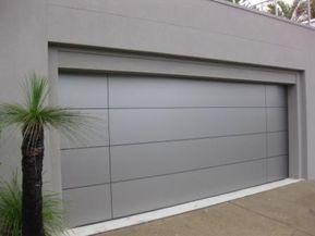 A Porta Da Garagem De Fetais Porta Da Garagem Fachadas De Casas Muros De Casas