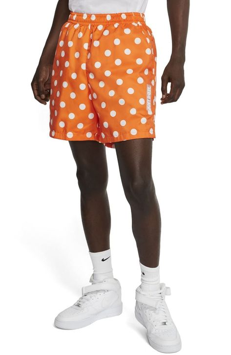 Oversize dots punctuate the sleek finish of sporty, wear-everywhere shorts marked with a translucent Just Do It patch on one leg.