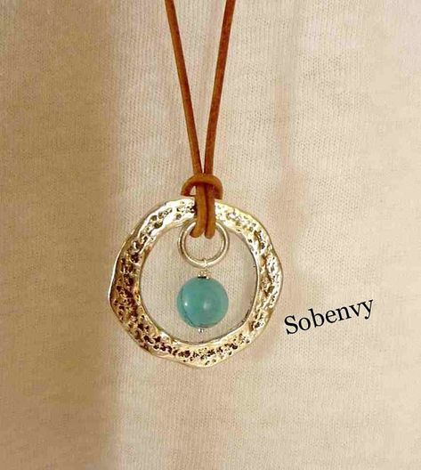 Leather Necklace Goes around comes around ring with a by SobeEnvy High quality leather Strung on to a Silver Metal Ring Silver Ring Turquoise Bead White ceramic bead for a closure. This necklace sits in the midsection of ones body reminder of what
