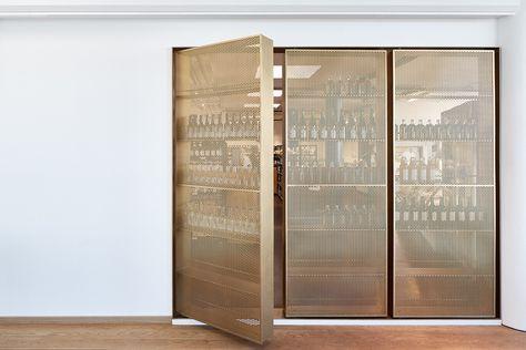 Door-like beverage storage designed by Retail Architects and Årstiderne Arkitekter. Photo by Mads Frederik.