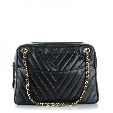 79d4fff08999 This chic vintage shoulder bag is crafted of a v-shaped chevron quilted  luxurious lambskin leather in black.