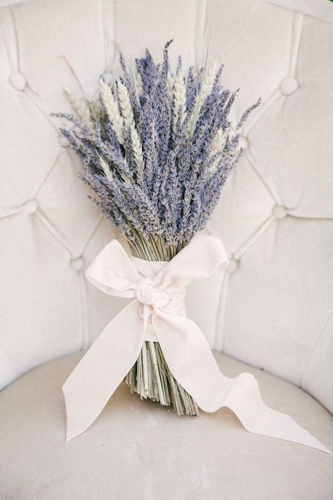 lavender bouquet wrapped in a cream bow