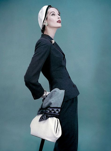 1955 Anne St. Marie in navy blue wool suit with longer jacket by unidentified designer, photo by Karen Radkai, Vogue
