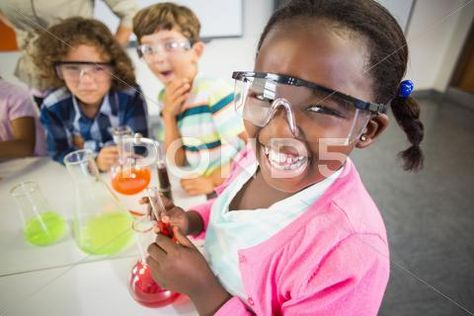 Kids doing a chemical experiment in laboratory at school ~ Hi Res #64613733