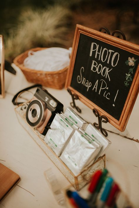 How fun is this guest book idea!? Fun wedding guest book ideas. Polaroid wedding guest book. Image by Juju Photography | Venue: Cross Creek Ranch | #tampaweddings #floridaweddings #bohowedding #rusticwedding #neutralwedding