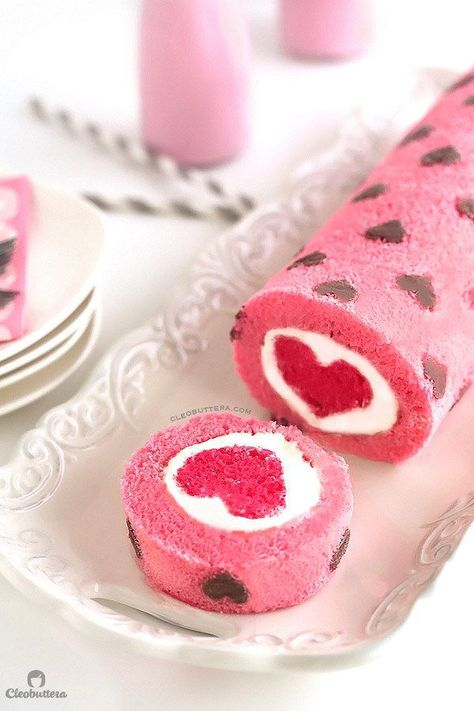 """""""Love is All Around"""" Cake Roll. Heart-patterned cake roll made easier with cake mix, filled with a cloud-like whipped cream cheese frosting, and unveils a cute heart with every slice! Valentines Day Food, Valentine Treats, Valentine Cake, Valentine Desserts, Valentine Sday, Printable Valentine, Homemade Valentines, Valentine Decorations, Swiss Roll Cakes"""