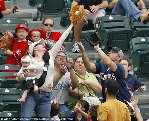 Well hello! Saw this AWESOME mom photo on the Daily Mail site of a Richmond Flying Squirrels game. How bout' them apples eh!? Multi-tasking at it's best.