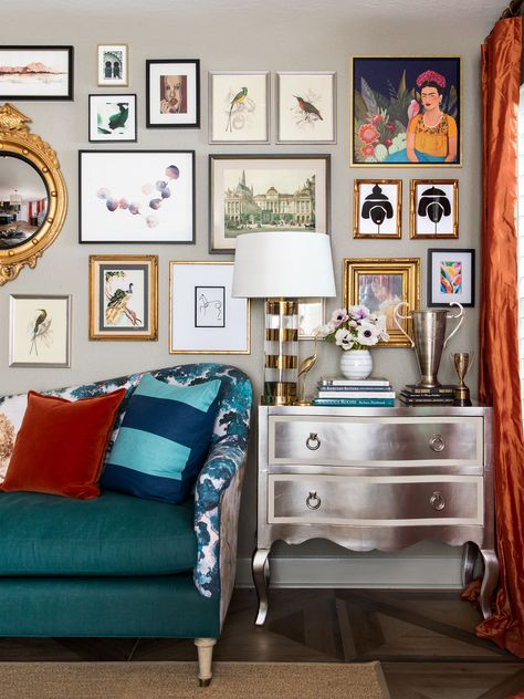Gold, silver and black frames create an art-filled gallery wall. See more on HGTV.com.