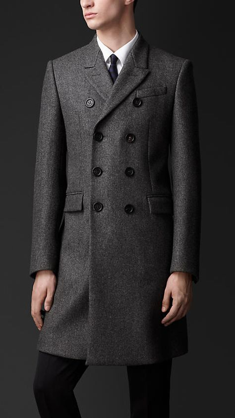 Chesterfield Coat- A coat with no waistline or side vents and can be single or double breasted.