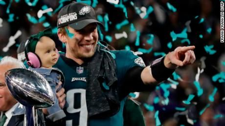 Philadelphia Eagles Quarterback Nick Foles 9 Holds His Daughter Lily James After Winning The Nfl Super Bowl 52 Football Game Against Super Bowl Sport Football Cnn Breaking News
