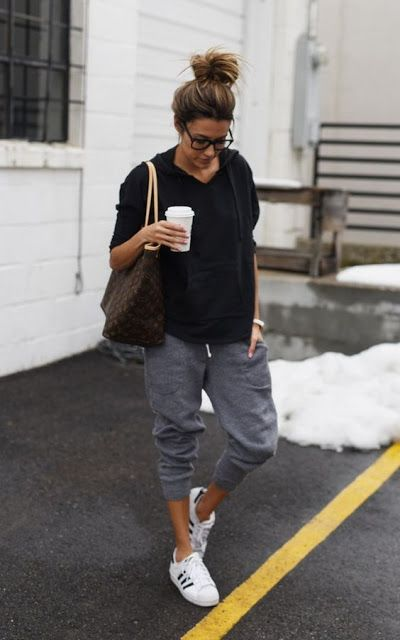 black pullover hoodie and gray sweat pants