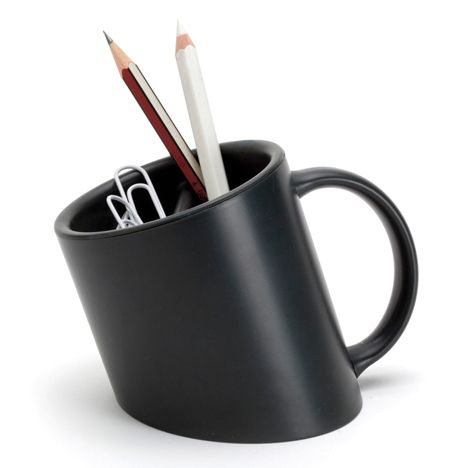 A pencil cup and stationery holder that appears to be sinking into the desk.