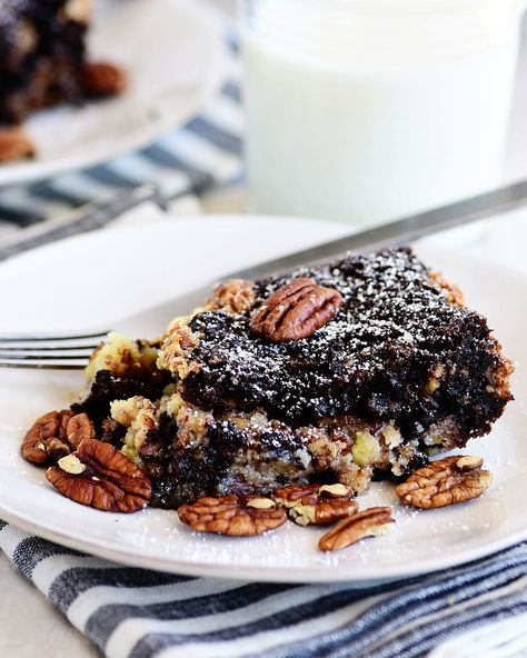 If you like pecan pie, you'll love this Chocolate Pecan Pie Gooey Butter Cake! This recipe takes two favorite desserts and combines them into the only thing that's better than a classic pecan pie. Print the full recipe at TidyMom.net #gooeybuttercake #pecanpie #pecan #ooeygooey #cakerecipes #cake #dessert #dessertrecipes #chocolate #chocolatecake #thanksgivingrecipes #thanksgivingdessert #holidayrecipes #tidymom