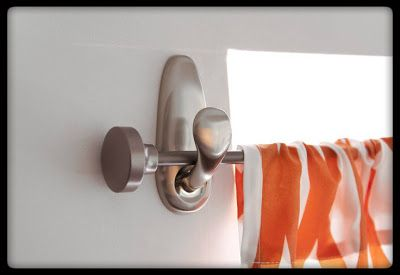 Use command hooks to hang curtains!  Easier than tension rods, and leave no holes or mess on the walls.  Great idea!!