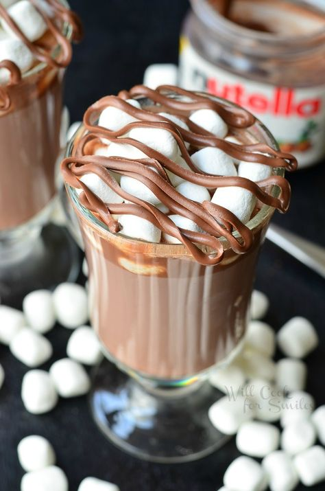 Spiked Nutella Hot Chocolate. Nutella Hot Chocolate spiked with hazelnut and coffee liqueurs, topped with marshmallows and more Nutella! from willcookforsmiles.com